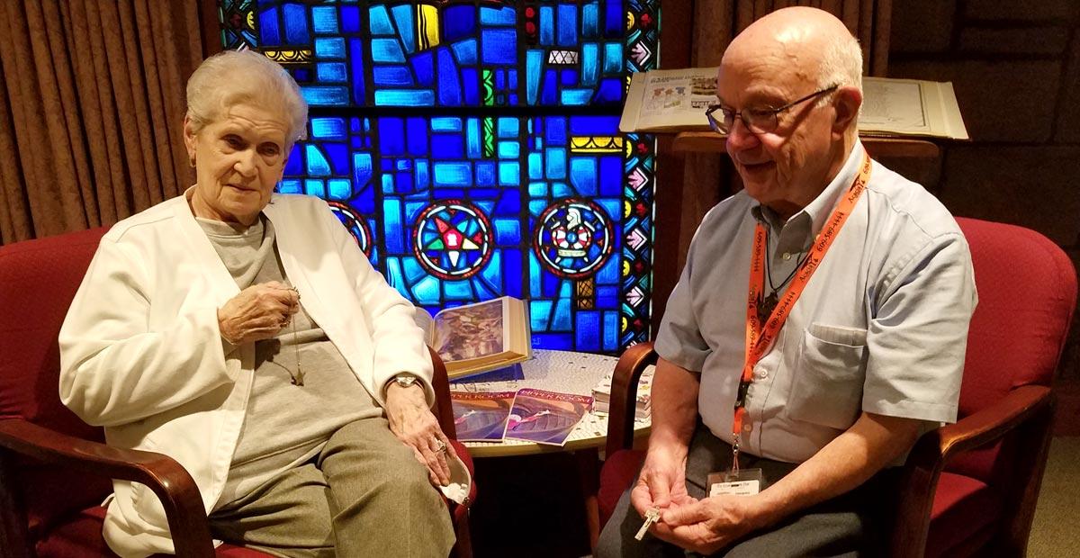 Bob Bursley volunteers with resident
